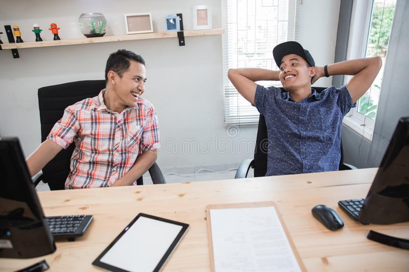 Relax worker having chat on work hour brake. In the office royalty free stock image