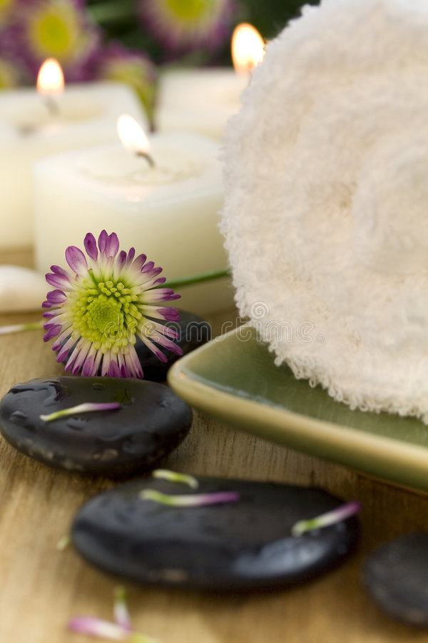Relaxation. Towel, flower, pebbles and candles spa therapy. Time to relax royalty free stock photography