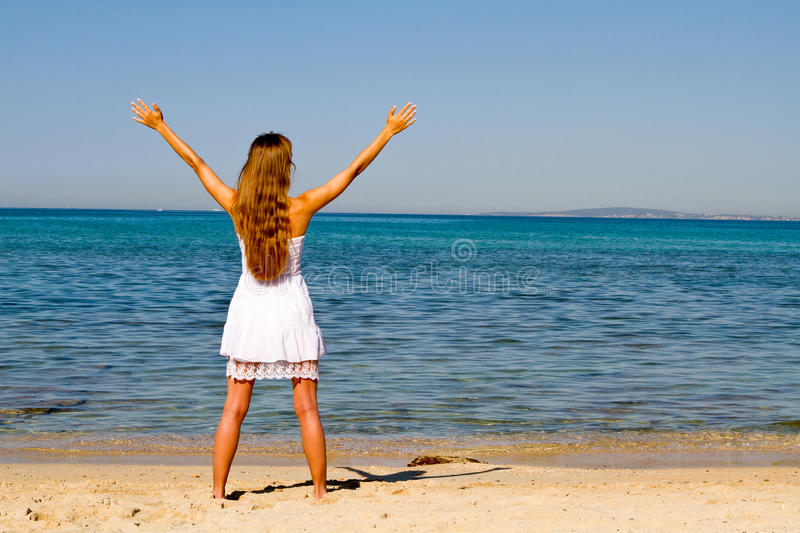 Relaxation On The Beach With Hands Up Stock Photos