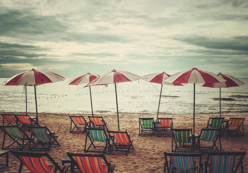 Relaxation on the beach in retro style stock images