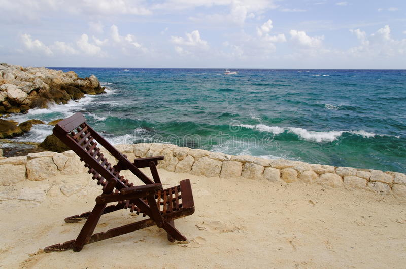 Relaxation chair with ocean view stock images