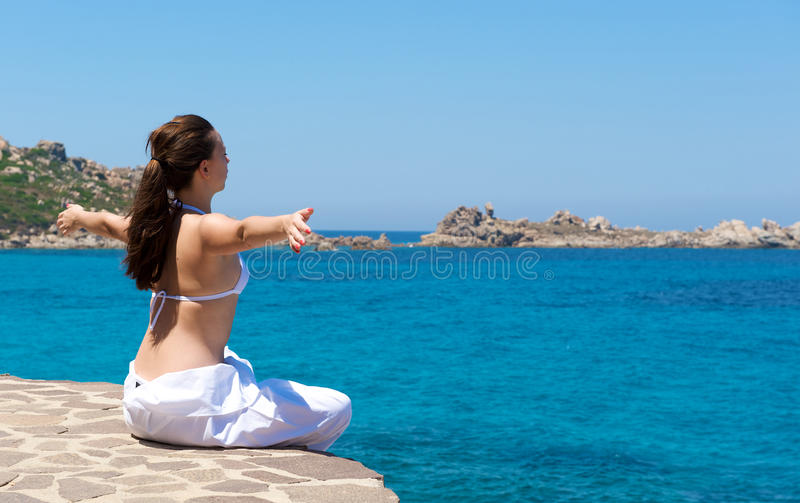 Download Relaxation Exercices On The Beach Stock Image - Image: 10530995