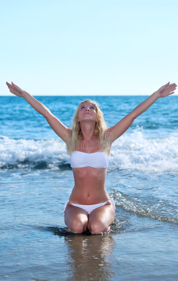 Download RELAXATION EXERCISE ON BEACH Stock Image - Image: 21671091