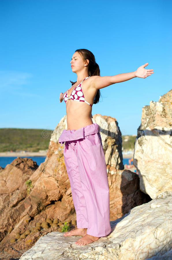 Download Relaxation Exercises With Sea View Stock Image - Image: 10596891