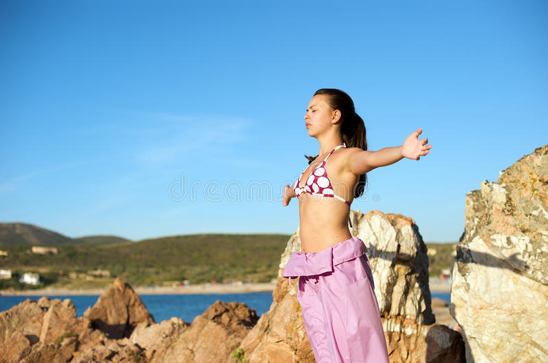 Relaxation Exercises With Sea View Royalty Free Stock Image