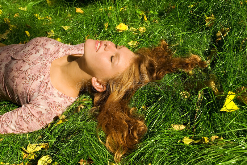 Relaxation on the grass. Relaxation on the bright grass stock photography