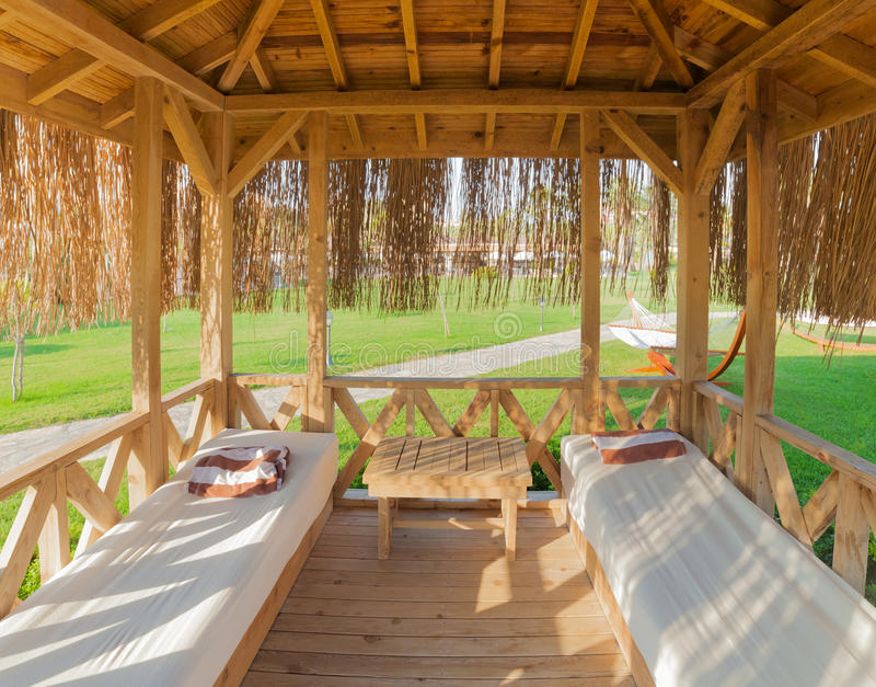 Relaxation hut in resort. Inside photograph of a hut near the sea royalty free stock image