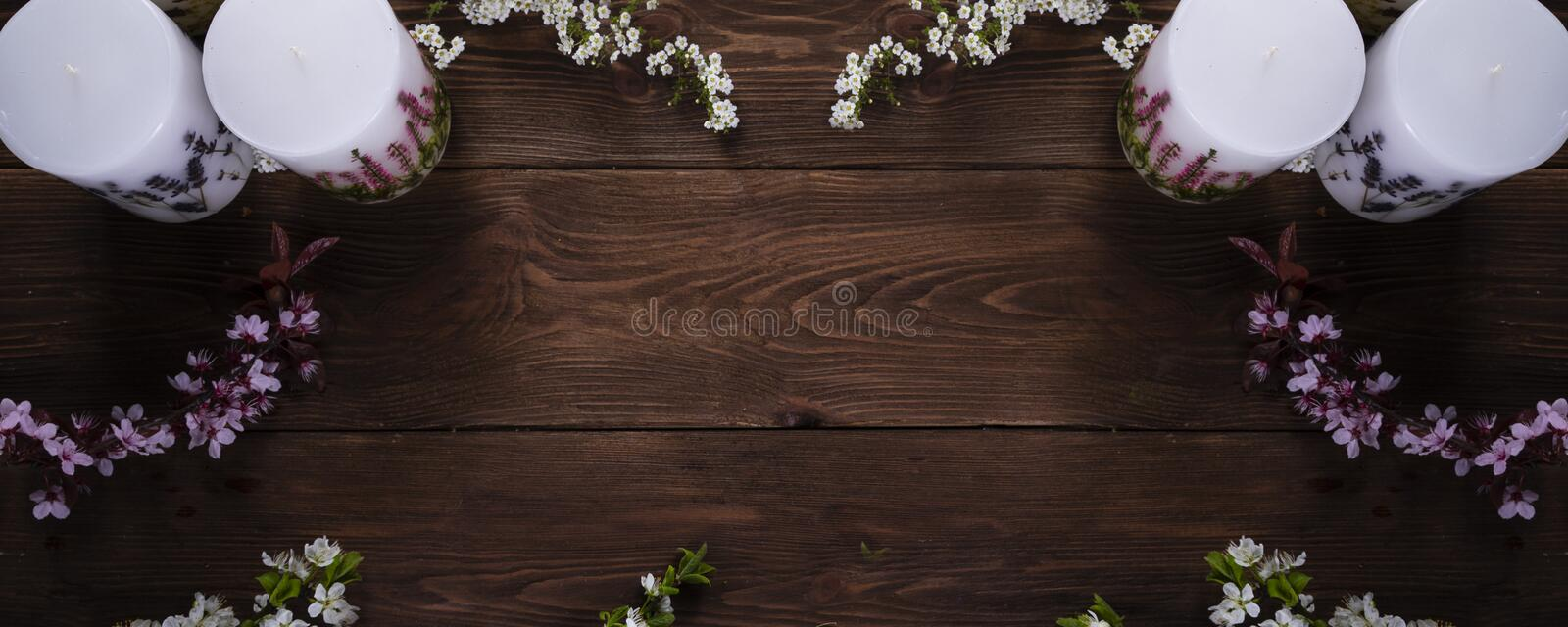 Relaxation and spa floral concept with candles on wooden background. Relaxation or spa floral concept with candles on wooden background stock photography