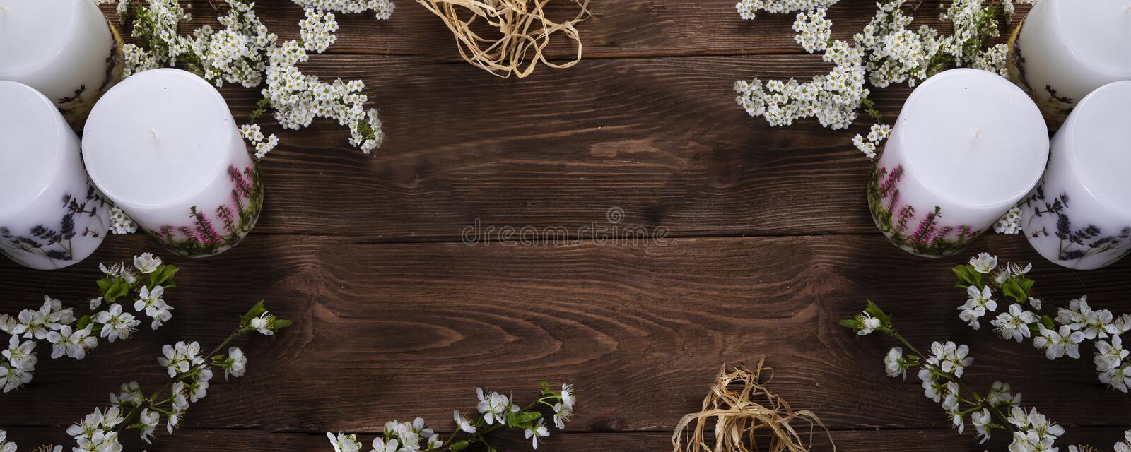 Relaxation and spa floral concept with candles on wooden background. Relaxation or spa floral concept with candles on wooden background stock photos