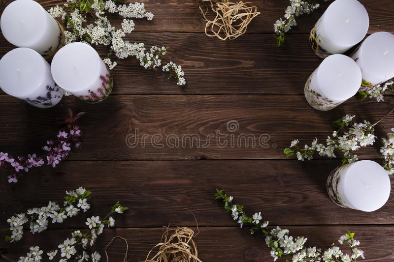 Relaxation and spa floral concept with candles on wooden background. Relaxation or spa floral concept with candles on wooden background stock image
