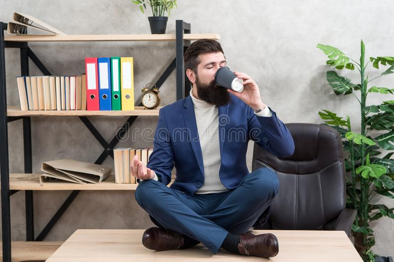 Relaxation techniques. Mental wellbeing and relax. Man bearded manager formal suit sit lotus pose relaxing. Prevent. Professional burnout. Way to relax stock photography