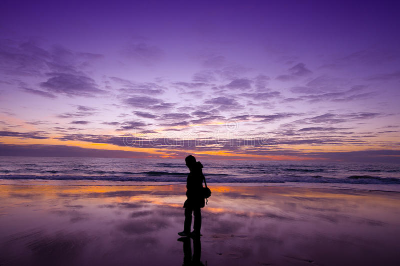 Relaxation walking on the beach at sunset royalty free stock image