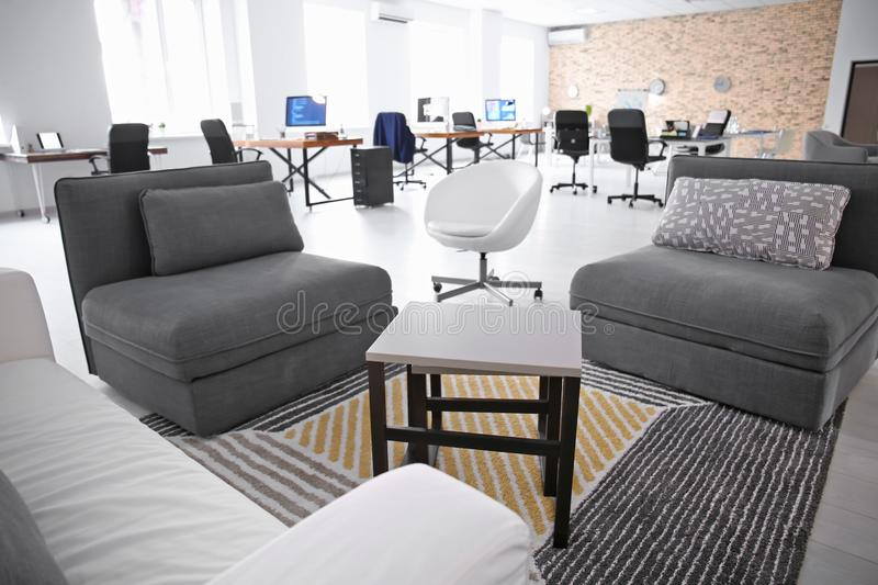 Relaxation zone in office with comfortable furniture. Workplace design royalty free stock photography