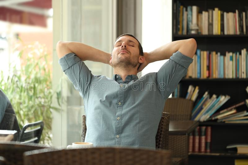 Relaxed adult man resting in a coffee shop stock photo