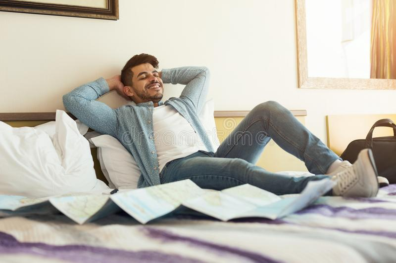 Relaxed arabic man lying on bed royalty free stock photo