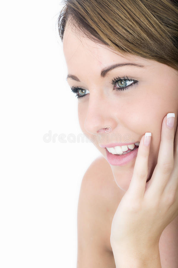 Relaxed Beautiful Young Woman Smiling with Hand on Cheek royalty free stock photo
