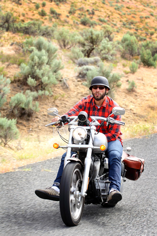 Relaxed Biker Riding stock images