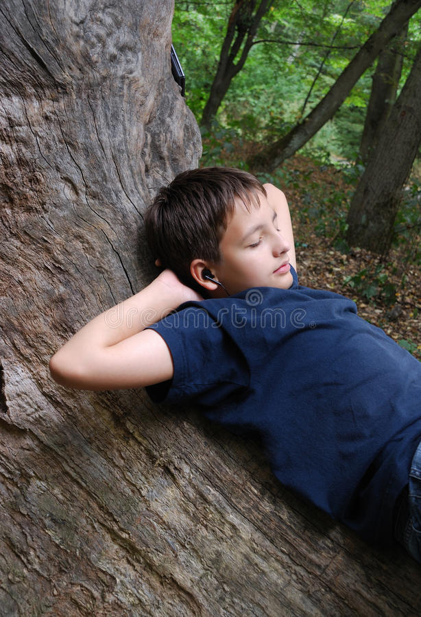Download Relaxed Boy On The Old Trunk Stock Image - Image: 38271839