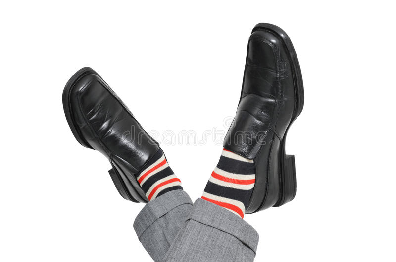 Relaxed businessman crossing his feet stock image