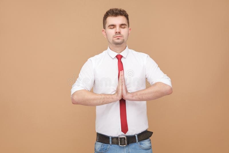 Relaxed businessman doing yoga stock image