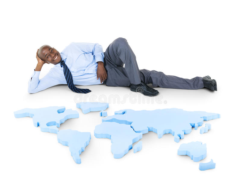 Relaxed Businessman on floor with Earth icon. stock photos
