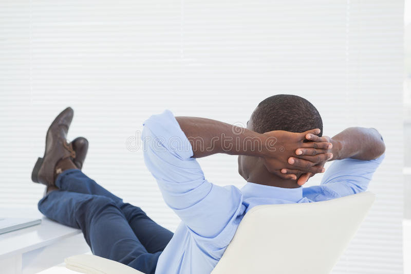 Relaxed businessman with his feet up stock photography