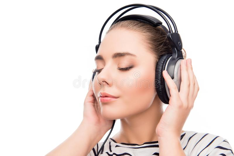 Relaxed calm girl listening music in headphones with closed eyes.  stock photos