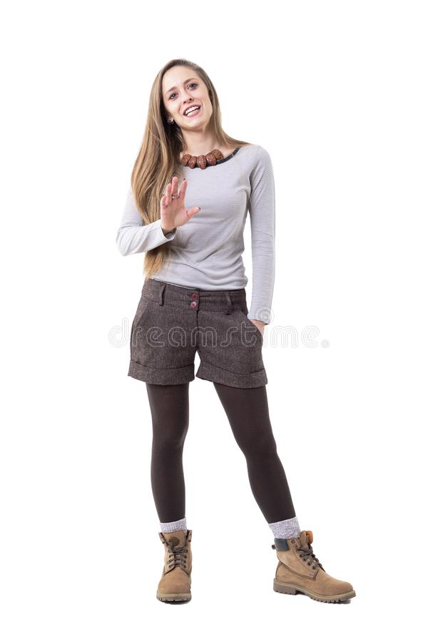 Relaxed candid happy hipster style young woman explaining, talking and gesticulating royalty free stock image