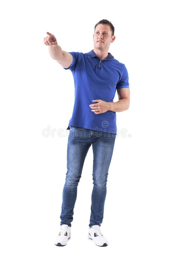 Relaxed casual man showing way directions pointing finger away and looking up. Full body isolated on white background royalty free stock images