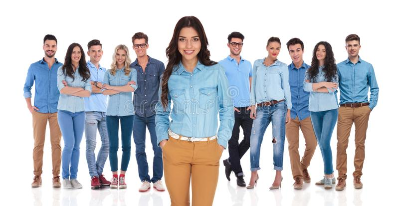 Relaxed casual woman standing in front of the team stock photography