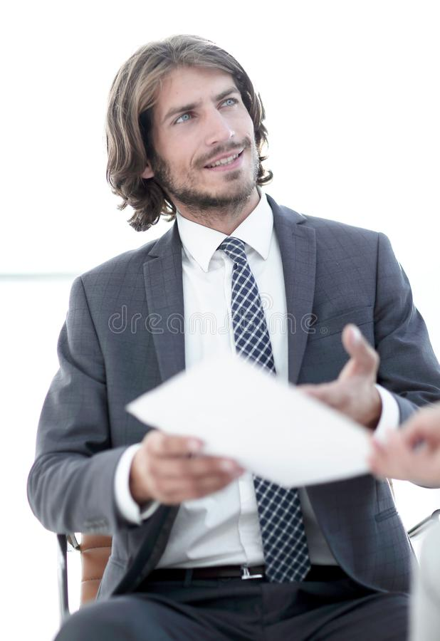 A relaxed conversation of a man and a woman in the office. Successful young consultants working as business team in an office analyzing documents stock images