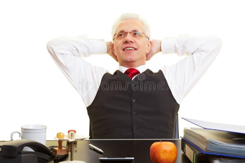 Relaxed elderly businessman stock photo