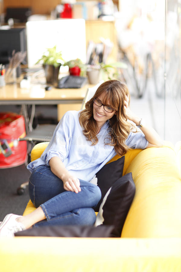Download Relaxed Female Executive In Office Stock Photo - Image: 31642834