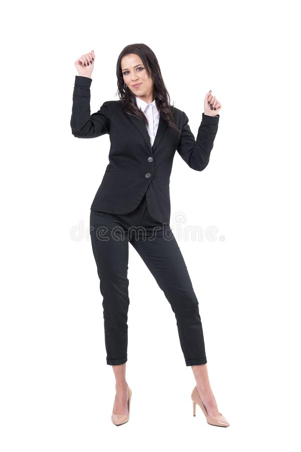 Relaxed happy business woman in formal suit celebrating good deal with raised arms. stock photography