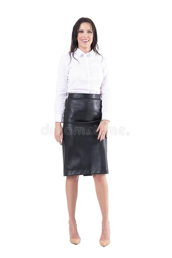 Relaxed happy spontaneous business woman smiling with arms down in formal clothes stock image