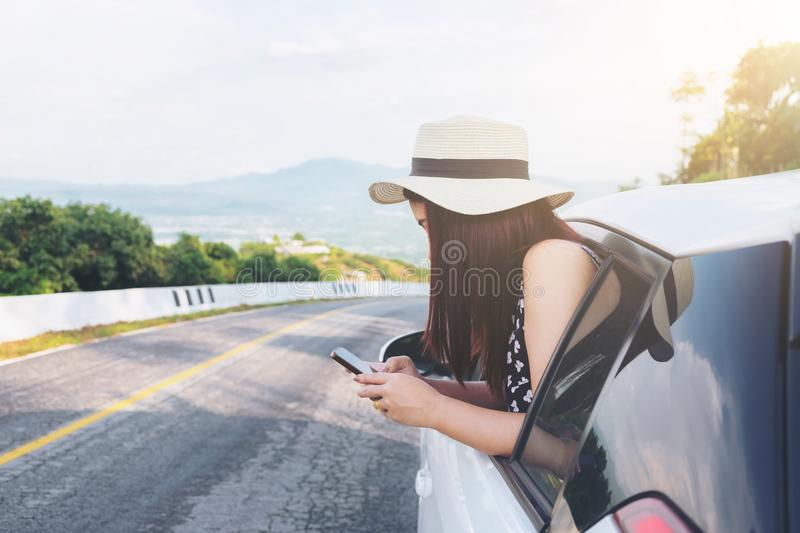 Relaxed happy traveler, Young beatiful asian gilr using smart ph stock images