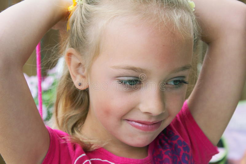 Download Relaxed Little Girl stock photo. Image of earrings, blond - 20531286