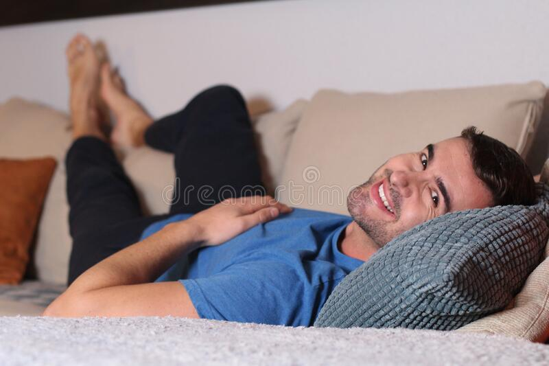 Relaxed man enjoying the sofa royalty free stock image