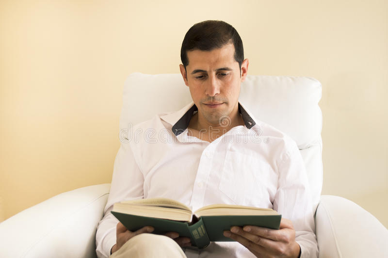 Download Relaxed man reading a book stock image. Image of looking - 30814205