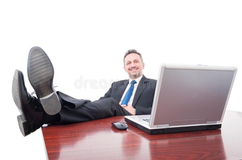 Relaxed manager smiling and taking a break stock images