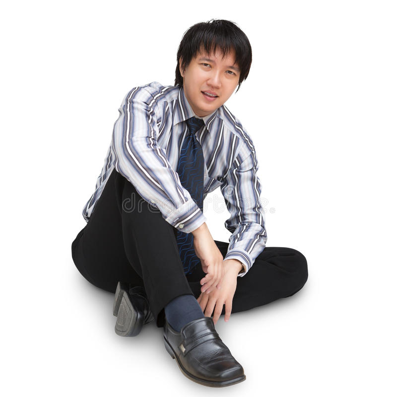 Relaxed mature business man sitting on the floor. Isolated over white with clipping path stock photo