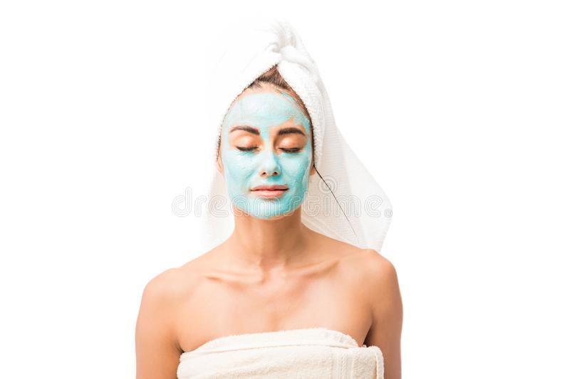 Beautiful Woman With Cosmetic Mask On Face stock photos