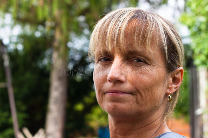 Relaxed middle aged woman face. Portrait of relaxed middle aged woman stock photo