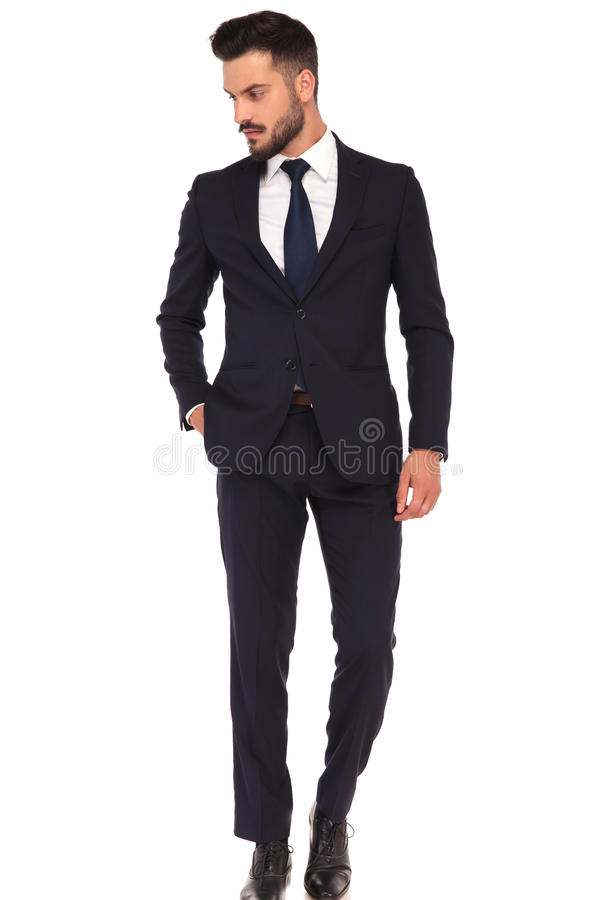 Relaxed modern business man standing with hand in pocket royalty free stock photography
