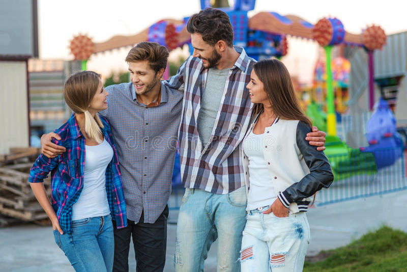 Relaxed people having a conversation outdoors royalty free stock images