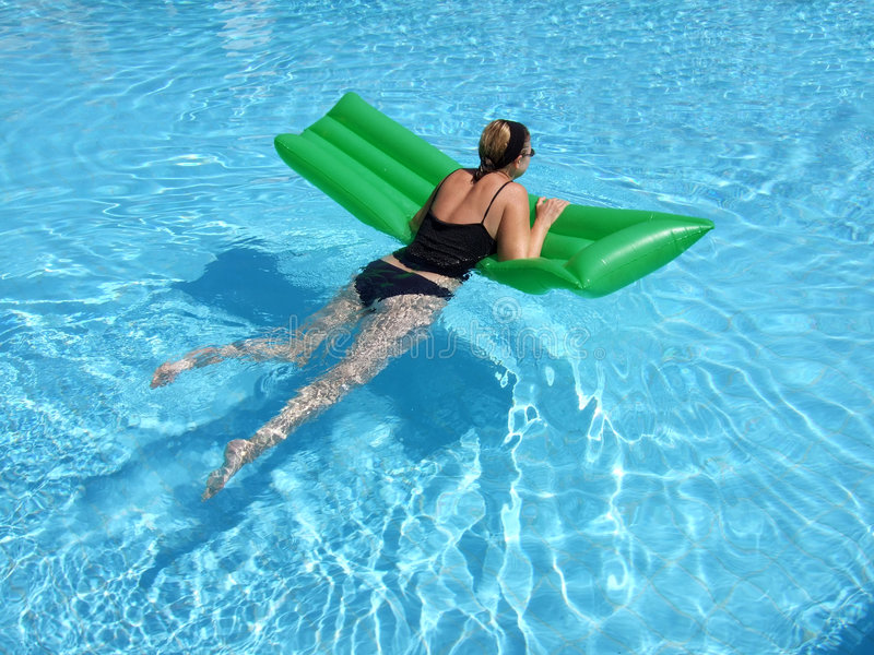 Relaxed in the Pool royalty free stock photography