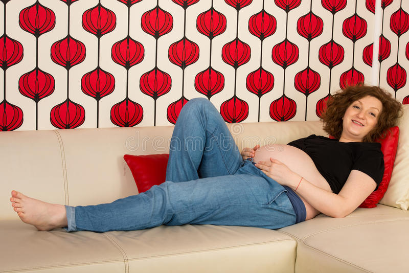 Relaxed pregnant home royalty free stock photography