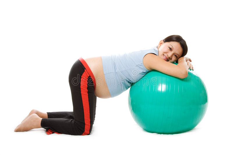 Relaxed pregnant woman. A pregnant woman doing relaxation with birth ball royalty free stock photo