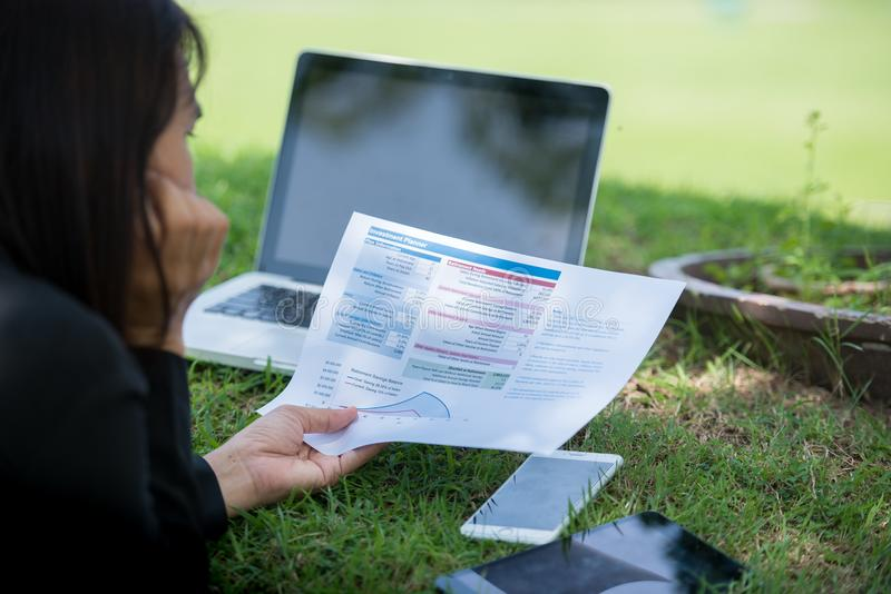 Relaxed Sales Managers Working Outdoor. Working Woman Showing Hand Market Report Charts royalty free stock photography