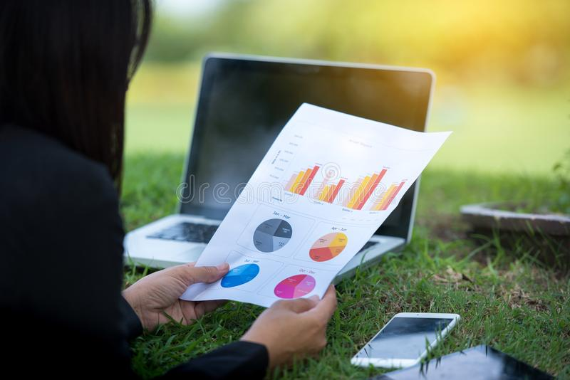 Relaxed Sales Managers Working Outdoor. Working Woman Showing Hand Market Report Charts.Planning New Strategy.Prepare Business Doc stock image